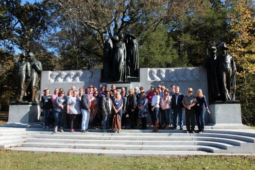 Conference attendees posing at Shiloh National Military Park monument