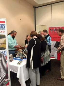 Conference attendees visiting South Central Tennessee booth