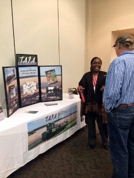 Conference attendees visiting T.A.R.A. Wildlife booth