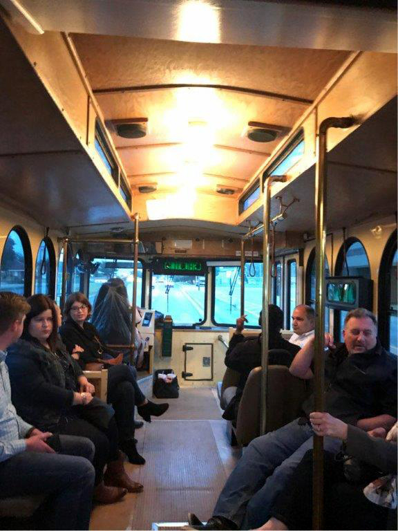 Conference attendees riding trolley to reception.