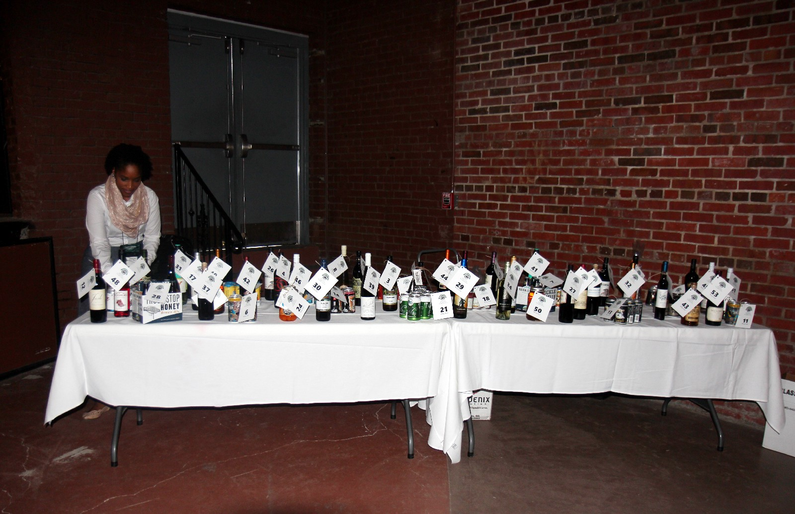 Spirits Pull table displaying wine and other spirits.