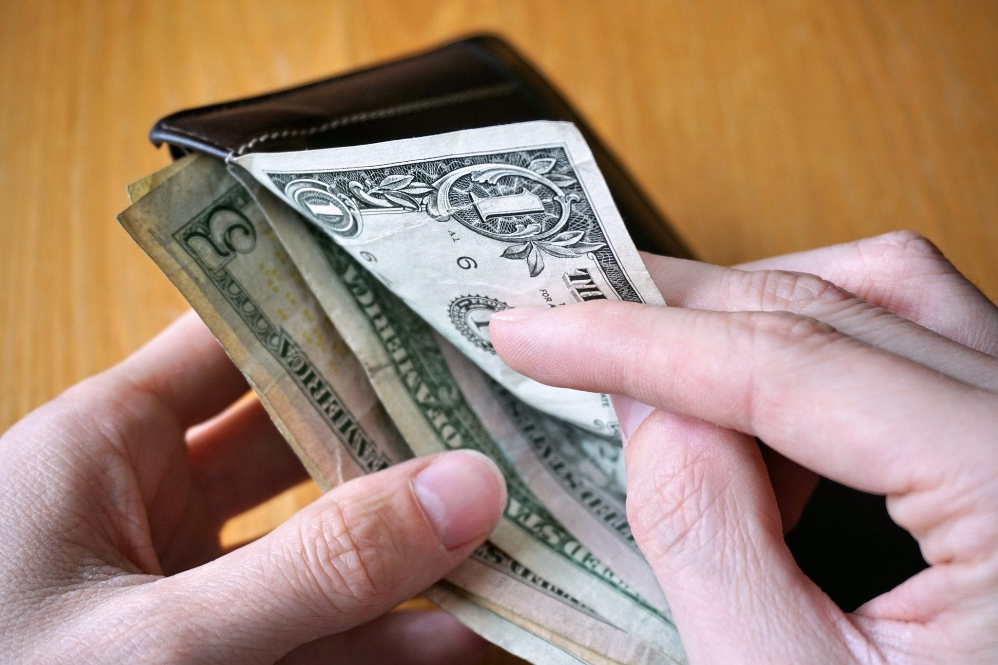 taking cash from a wallet